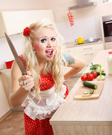pin up: Mad woman in the kitchen Stock Photo