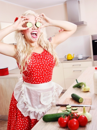 Crazy housewife is having fun in the kitchen photo