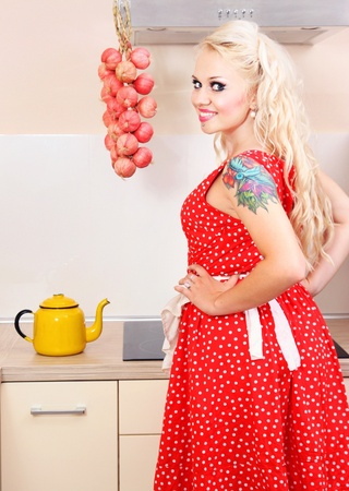 sexy housewife: Cheerful housewife in the kitchen Stock Photo