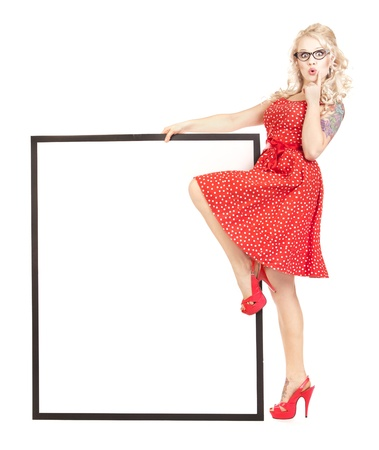 pin board: Sexy pinup girl with a blank presentation board Stock Photo