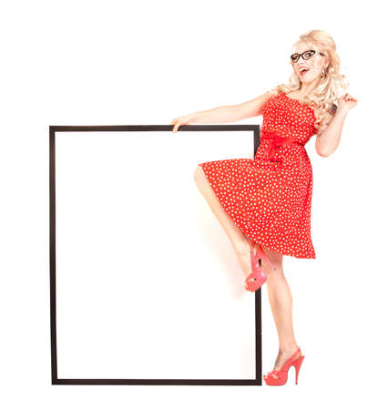 Sexy pinup girl with a blank presentation board  photo