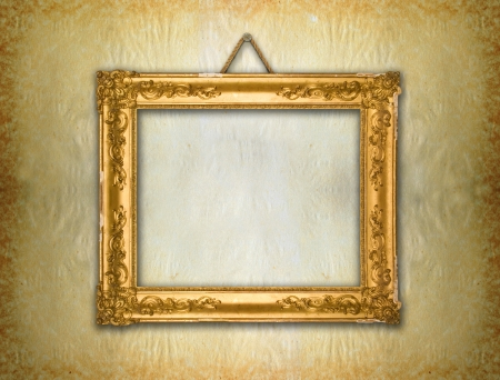 Gold frame, aged wallpaper  photo