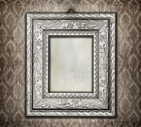 Beautiful ornate frame on a vintage wallpaper  photo