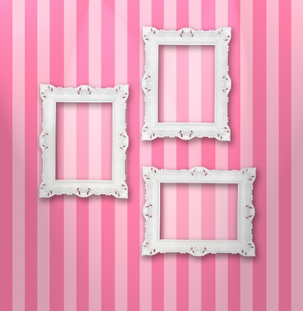 color photo: Set of white ornamental frames on a stripy wallpaper Stock Photo