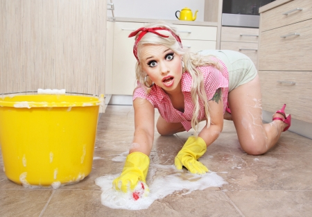 pin up: Attractive house wife is cleaning floor Stock Photo