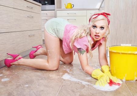 retro housewife: Attractive house wife is cleaning floor Stock Photo