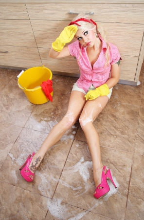 housewife gloves: Cute tired cleaner Stock Photo