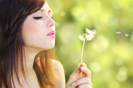 Girl with dandelion  photo