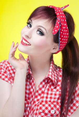 pinup girl: Cheerful pin up girl - retro style portrait  Stock Photo