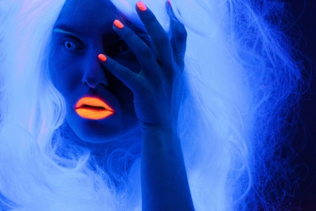 Uv light portrait, woman with glowing accessories and make up  Stock Photo - 16740175
