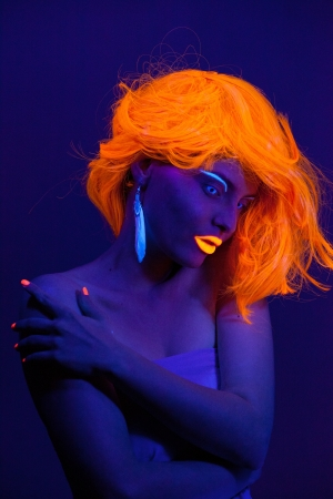 ultraviolet: Uv light portrait, woman with glowing accessories and make up  Stock Photo
