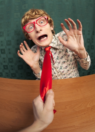 coward: Scared office worker Stock Photo
