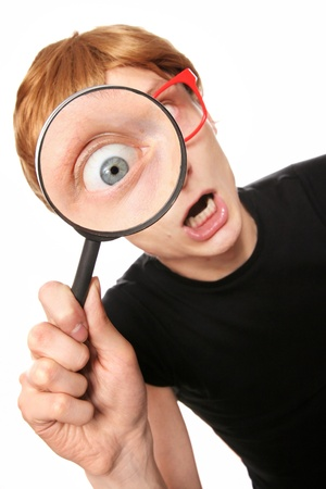 inspect: Excited nerd with magnifying glass