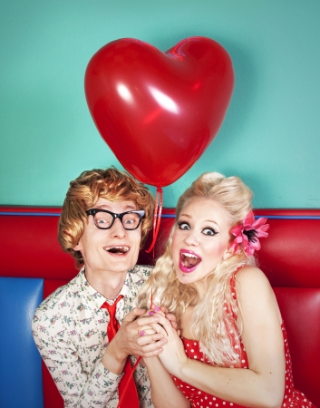 valentine's: Happy nerdy couple celebrating valentine s day  Stock Photo