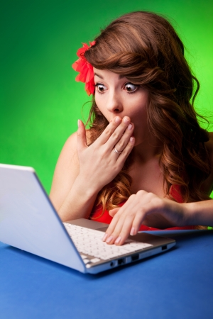 Surprised young woman at a computer  Stock Photo