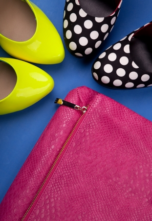 Colorful high heels and snakeskin print bag photo