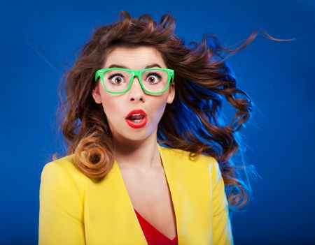 astonished: Colorful portrait of an attractive surprised girl