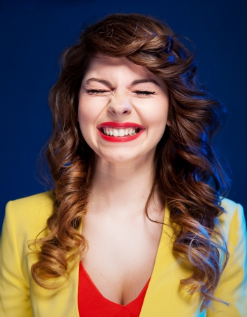 Portrait of an attractive young woman laughing hard  photo