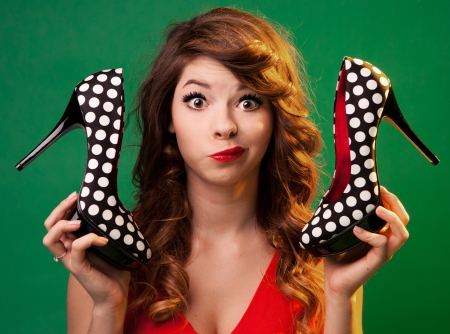 Funny young woman holding high heels shoes  Stock Photo
