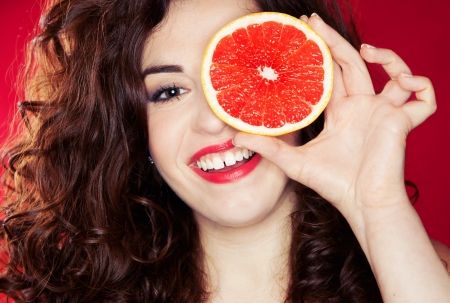 Portrait of pretty woman holding grapefruit  photo