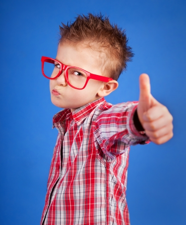 attitude boy: Cool five years old boy showing ok sign  Stock Photo