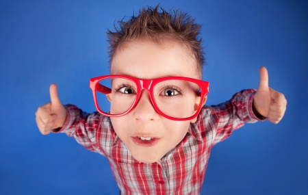 Cool five years old boy showing ok sign  Stock Photo