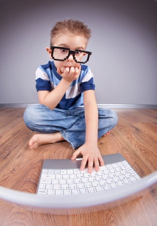 Little boy with laptop computer  photo