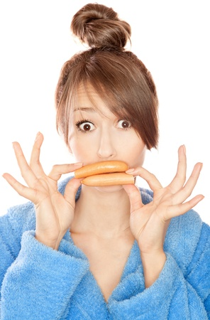 Woman with sausages simulating lip enhancement she s dreaming of filler injection Stock Photo - 18473326