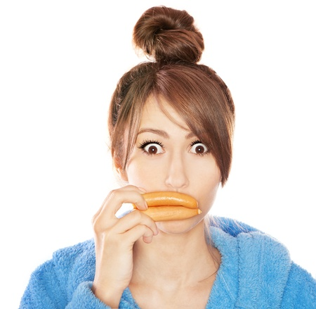 Woman with sausages simulating lip enhancement she s dreaming of filler injection Stock Photo - 18473271