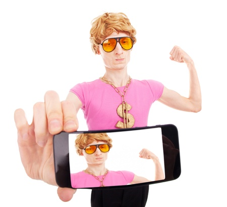 narcissism: Funny macho guy taking a self portrait with smart phone