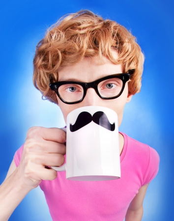 moustaches: Funny nerdy guy drinking tea Stock Photo