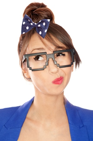 pondering: Nerdy thoughtful young brunette woman wearing 8 bit glasses