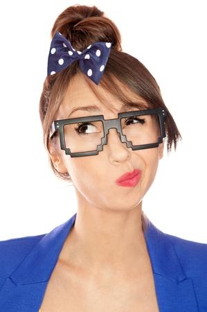 nerdy: Nerdy thoughtful young brunette woman wearing 8 bit glasses