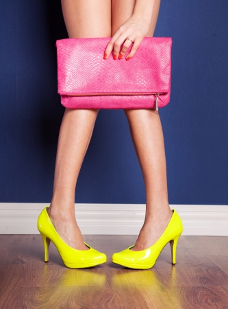 Girl wearing high heels and holding a bag photo