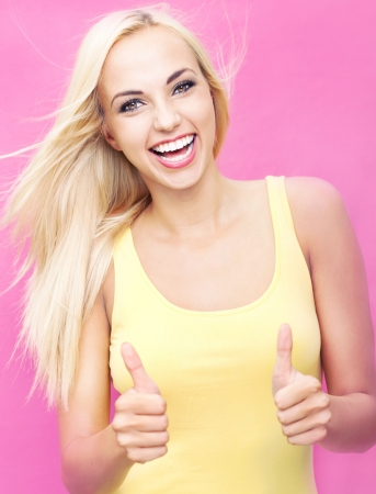 super woman: Beautiful young woman with an amazing smile showing thumbs up