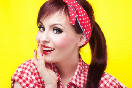 Attractive surprised pin up girl - retro style portrait photo