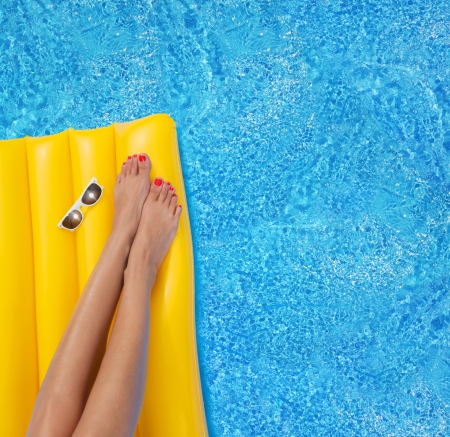 colorfully: Woman relaxing in a pool - feet close up Stock Photo