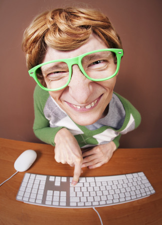computer programmer: Funny guy at the computer Stock Photo