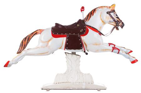 juguetes antiguos: Vintage feliz vuelta caballo aislado en blanco Foto de archivo