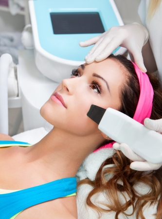Woman getting laser face treatment in medical spa center  Stock Photo