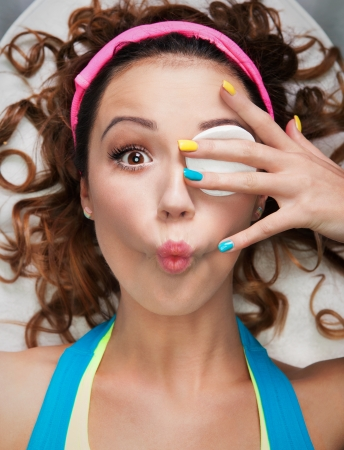 Make up removal concept, woman with cotton pad making funny face Banco de Imagens
