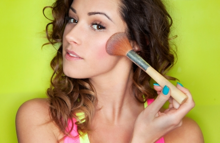 Applying make up concept, woman with cosmetic brush photo