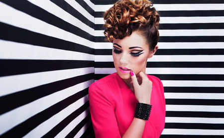 glam rock: Portrait of beautiful young woman with professional party make up Stock Photo