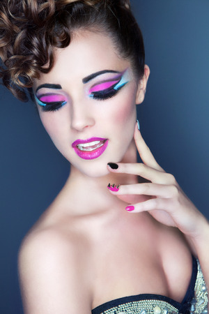 nail art: Beautiful young woman with professional party make up