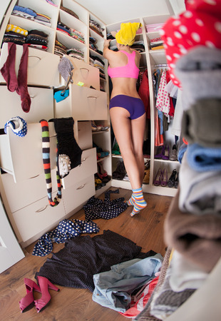 Getting dressed concept, woman after shower in walk in closet  Stock Photo