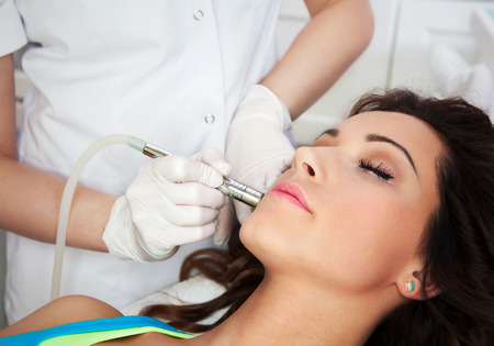 resurfacing: Woman getting laser face treatment in medical spa center, skin rejuvenation concept  Stock Photo