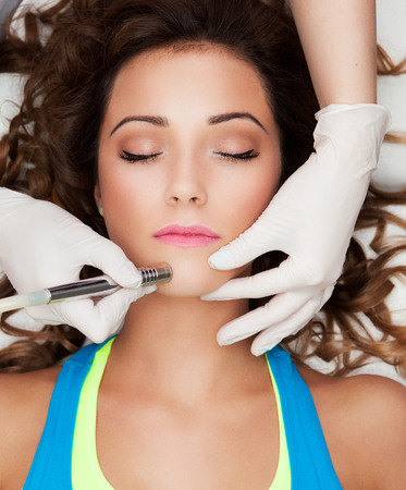 dermatology: Woman getting laser face treatment in medical spa center, skin rejuvenation concept  Stock Photo