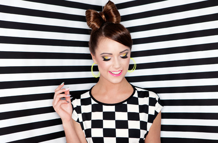 glam: Attractive young woman on stripy background, beauty and fashion concept  Stock Photo