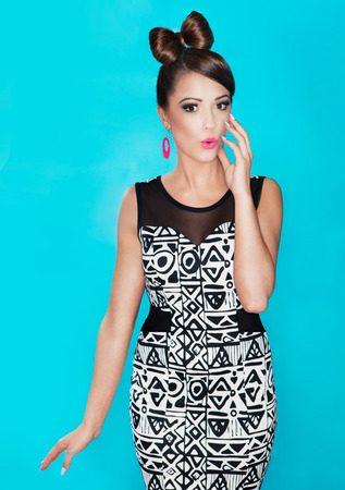 Young attractive fashionable surprised woman