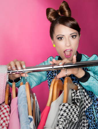 Young attractive woman with clothes rack  photo